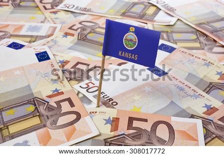 Flag of Kansas sticking in european banknotes.(series) - stock photo