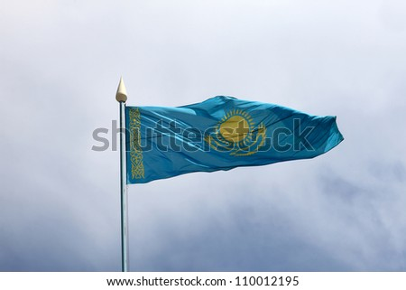Flag of Kazakhstan is waving on the sky background