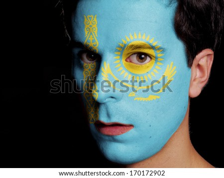 Flag of Kazakhstan Painted on a Face of a Young Man - stock photo