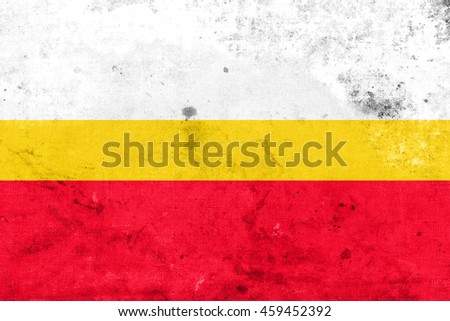 Flag of Lesser Poland Voivodeship, Poland, with a vintage and old look - stock photo