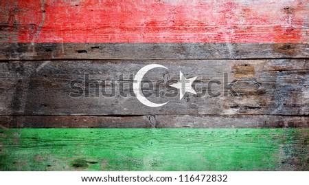 Flag of Libya painted on grungy wood plank background - stock photo