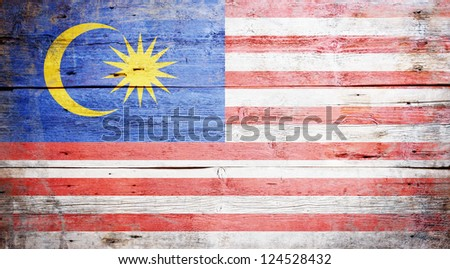 Flag of Malaysia painted on grungy wood plank background - stock photo
