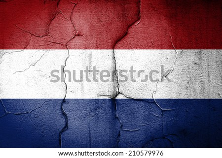 flag of Netherlands painted on cracked wall - stock photo