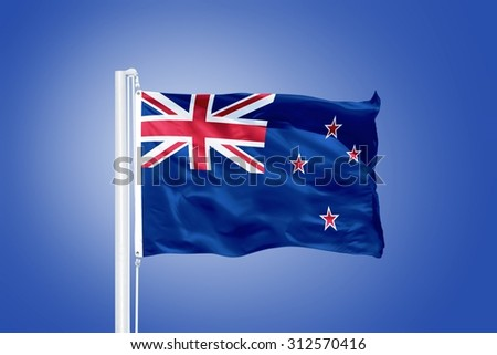 Flag of New Zealand flying against a blue sky.