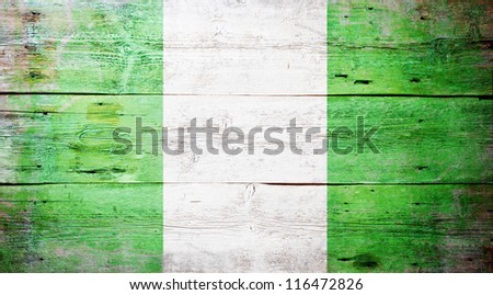 Flag of Nigeria painted on grungy wood plank background - stock photo