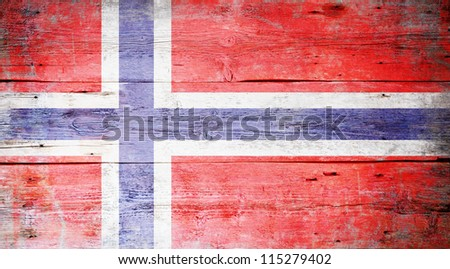 Flag of Norway painted on grungy wood plank background - stock photo