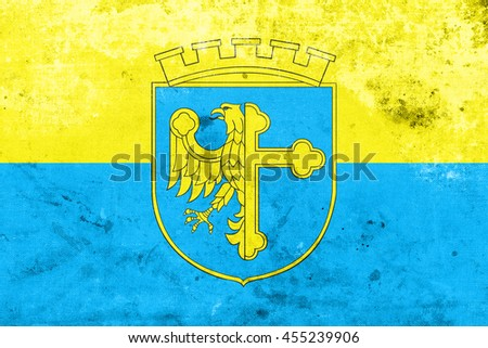 Flag of Opole with Coat of Arms, Poland, with a vintage and old look - stock photo