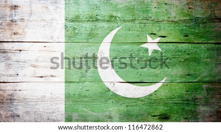 Flag of Pakistan painted on grungy wood plank background - stock photo