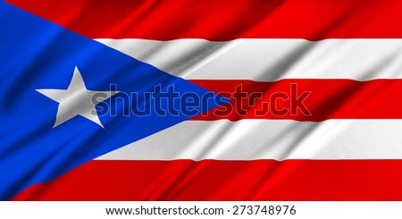 Flag of Puerto Rico waving in the wind - stock photo