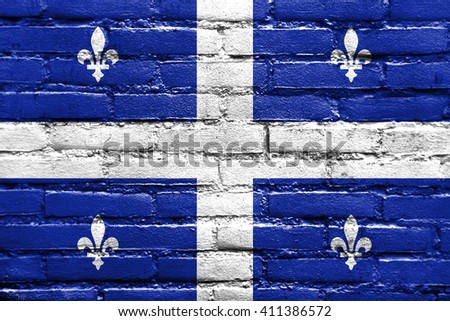 Flag of Quebec, painted on brick wall - stock photo