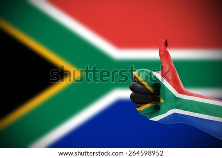 Flag of Republic of South Africa on female's hand, defocused flag in background - stock photo