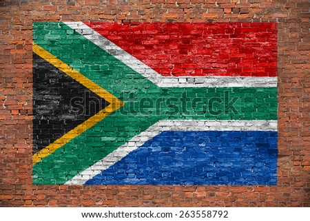 Flag of Republic of South Africa painted over aged brick wall - stock photo