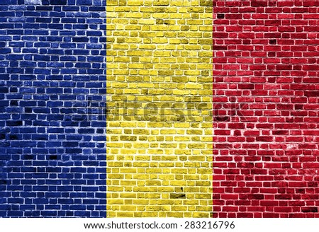 Flag of Romania painted on brick wall, background texture