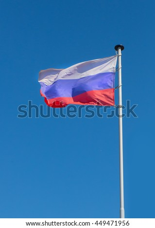 flag of Russia fluttering on wind against the sky - stock photo