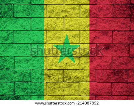 Flag of Senegal painted onto a grunge brick wall  - stock photo