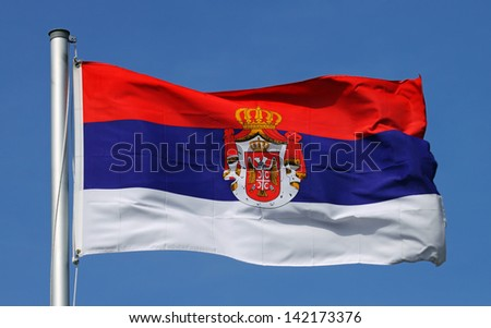 Flag of Serbia on a sunny day - stock photo