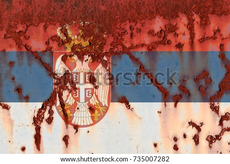 Flag of  Serbia  the rusty background.  Concept photo