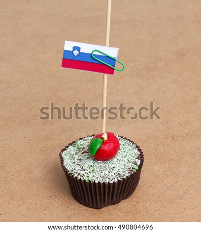 Flag of slovenia on cupcake on wood background