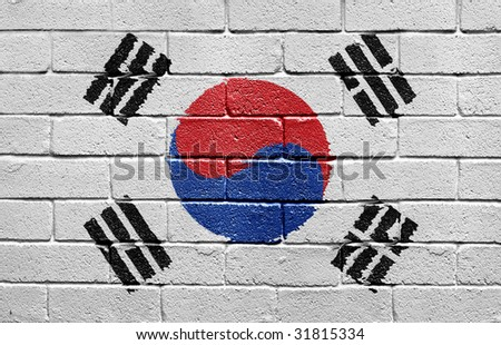 Flag of South Korea painted onto a grunge brick wall - stock photo