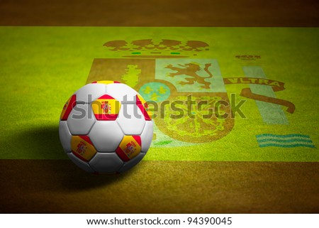 Flag of spain with soccer ball over grass background