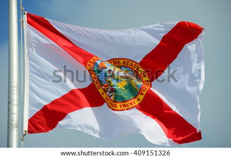 Flag of State of Florida in blue sky background - stock photo