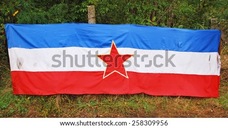 Flag of the former Socialist Federal Republic of Yugoslavia - stock photo