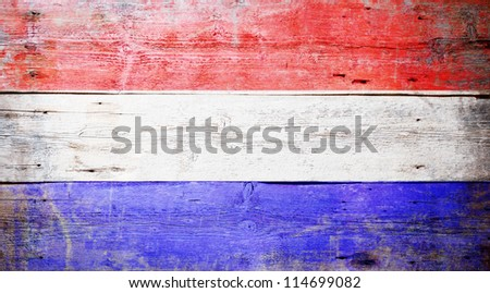Flag of the Netherlands painted on grungy wood plank background - stock photo