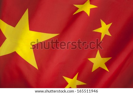 Flag of The Peoples Republic of China. The red represents the communist revolution; the five stars represent the unity of the Chinese people under the leadership of the Communist Party of China. - stock photo