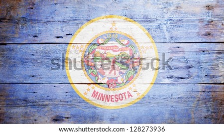 Flag of the state of Minnesota painted on grungy wooden background - stock photo