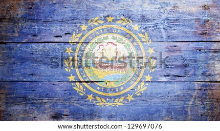 Flag of the state of New Hampshire painted on grungy wooden background - stock photo