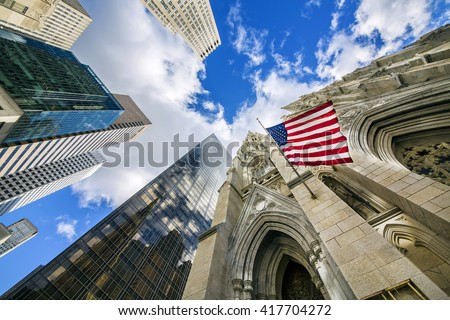 Flag of the United States on St Patrick's Cathedral among Midtown Skyscrapers, Manhattan, New York