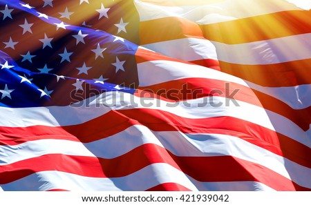 Flag of the USA with sunflare  - stock photo