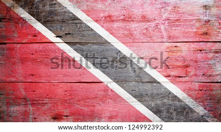 Flag of Trinidad and Tobago painted on grungy wood plank background - stock photo