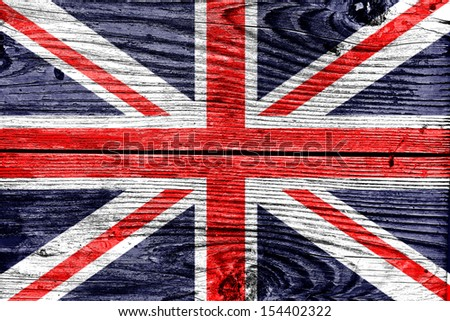 flag of United Kingdom painted on wooden frame - stock photo