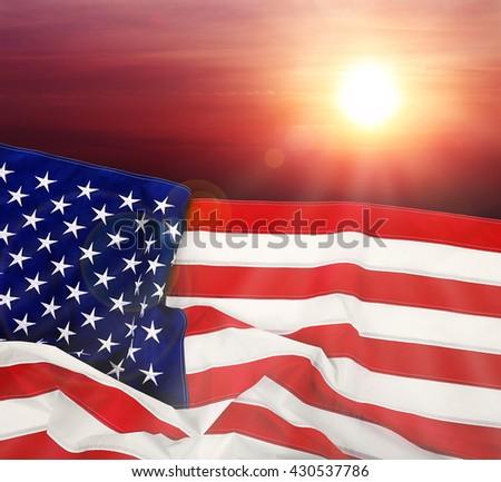 Flag of United States of America on sunset background - stock photo