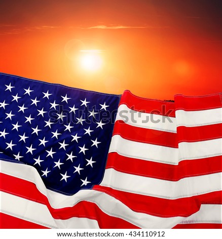 Flag of United States of America on sunset background