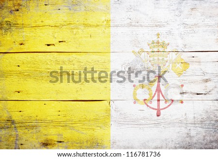 Flag of Vatican City painted on grungy wood plank background - stock photo
