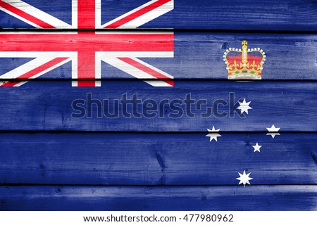 Flag of Victoria State, Australia, painted on old wood plank background