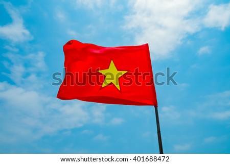 Flag of Vietnam on blue sky background - stock photo