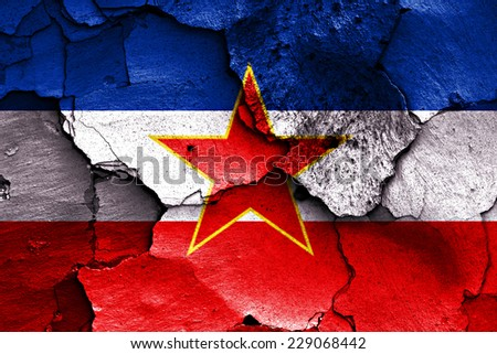 flag of Yugoslavia painted on cracked wall - stock photo