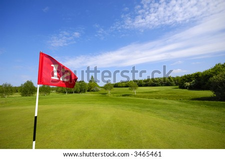 Flag on a golf course. - stock photo
