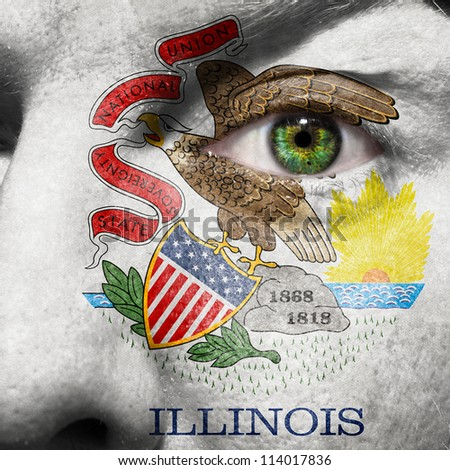 Flag painted on face with green eye to show Illinois support - stock photo