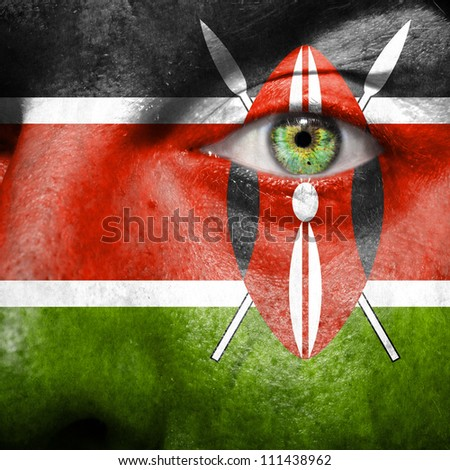 Flag painted on face with green eye to show Kenya support