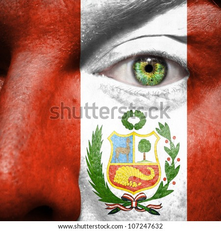 Flag painted on face with green eye to show Peru support