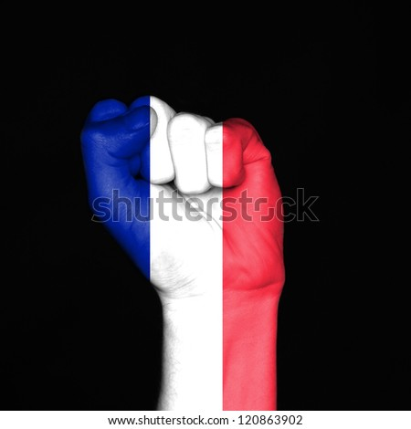 flag painted on fist over black background. Symbol of strength and unity. - stock photo