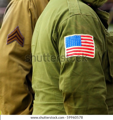 Flag patch on american soldier uniform. - stock photo