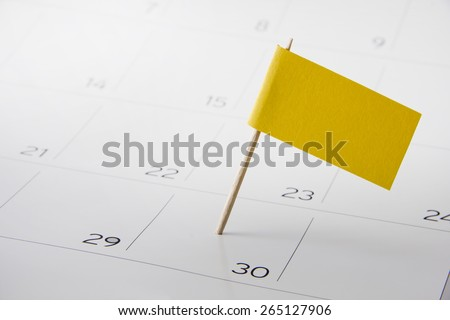 Flag the event date on calendar 2015 - stock photo