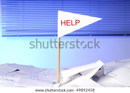 flag with help sticking out of desk full of papers - stock photo