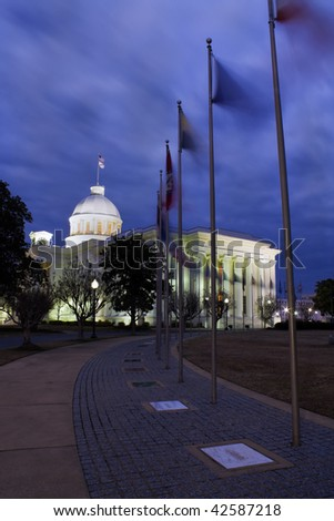 Flaggs of 50 states in fronts of State Capitol of Alabama in Montgomery. - stock photo