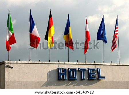 Flags above the hotel - stock photo